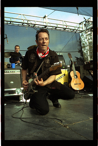 Joe Strummer performing at Hootenanny at Embarcadero Park, 2002.  It would be his last ever show in America.  Photo by the amazing Eric Rife.  Click to see more of his work.