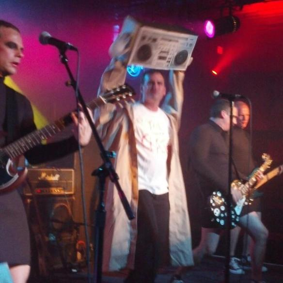 Blasphemous Guitars as Lloyd Dobler & Robert Palmer girls, Belly Up Halloween 2012.  Photo by Kevin Manuel.