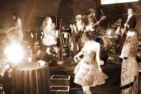 Yoko's 75th birthday party. Yuka Honda (keyboards), Emi (dancing), Yoko Ono (vocal), Sean Lennon (bass), Russell Simins (drums), Harper Simon (guitar)
