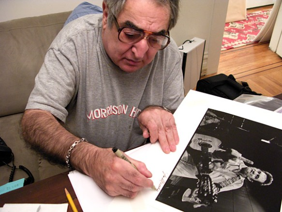 Jim Marhsall signing his famous photo.  Photo by Grover Sanschagrin