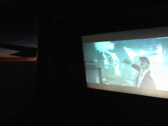 Watching Nick Cave documentary 20,000 Days on Earth at 20,000 feet over the Atlantic as the sun comes up bright red.